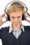 Adolescente confiado que escucha la música Foto de archivo libre de regalías