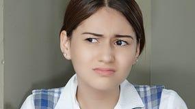 Adolescente confuso de la muchacha Imágenes de archivo libres de regalías