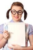 Adolescente de Geeky con la libreta Imagen de archivo libre de regalías