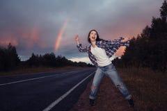 Adolescente de la chica joven con el arco iris Imagen de archivo