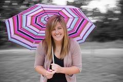 Adolescente de la diversión con el paraguas Imágenes de archivo libres de regalías