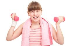 Adolescente de la muchacha con pesas de gimnasia Foto de archivo