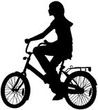 Adolescente de la muchacha en una bici Imagen de archivo