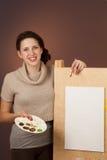 Adolescente de la muchacha que pinta un cuadro Fotografía de archivo