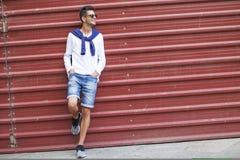 Adolescente de moda en la pared Imagen de archivo libre de regalías