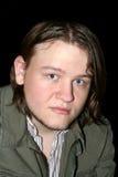 Adolescente de ojos azules en chaqueta militar Fotos de archivo