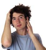 Adolescente de orejas ca3idas con una mirada agujereada en su cara. Foto de archivo