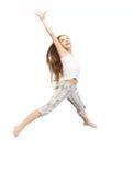 Adolescente de salto Foto de archivo libre de regalías
