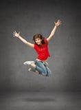 Adolescente de salto feliz Imágenes de archivo libres de regalías
