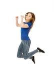 Adolescente de salto feliz Imagen de archivo libre de regalías