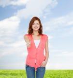 Adolescente de sorriso na roupa ocasional Imagem de Stock