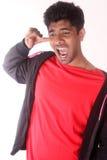 Adolescente de Youngindian que obstrui as orelhas com os dedos isolados no fundo branco Imagem de Stock Royalty Free