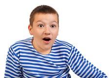 Adolescente del muchacho aislado en un fondo blanco Imagen de archivo