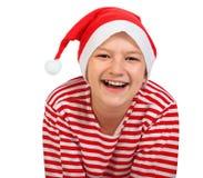 Adolescente del muchacho con el sombrero de Papá Noel Fotografía de archivo