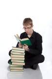 Adolescente del muchacho con los libros en el blanco Foto de archivo libre de regalías