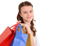 Adolescente del primer con los bolsos de compras Fotos de archivo