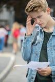 Adolescente deludente con i risultati dell'esame Immagini Stock Libere da Diritti
