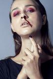 Adolescente depressioned problema con la nariz de la sangría Fotografía de archivo