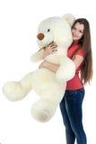 Adolescente derecho con el oso de peluche Fotografía de archivo