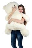 Adolescente derecho con el oso de peluche blanco Imágenes de archivo libres de regalías