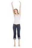 Adolescente despreocupado en pantalones vaqueros encima Imagen de archivo