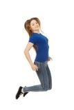 Adolescente di salto felice Immagini Stock