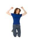 Adolescente di salto felice Fotografie Stock