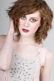 Adolescente dirigido vermelho bonito Foto de Stock Royalty Free