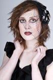 Adolescente dirigido vermelho bonito no véu Fotos de Stock Royalty Free