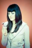 Adolescente distraída con el Lollipop Imagenes de archivo