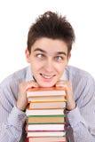 Adolescente divertido con los libros Imágenes de archivo libres de regalías