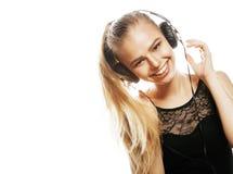 Adolescente dulce joven en el canto de los auriculares aislado Fotos de archivo