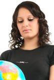 Adolescente e globo Imagens de Stock