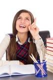 Adolescente elegante en el escritorio que tiene una idea brillante Fotografía de archivo