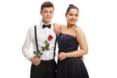 Adolescente elegante vestido con una flor color de rosa y un g adolescente Imagen de archivo