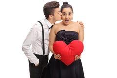 Adolescente elegante vestido que besa a su novia Fotos de archivo libres de regalías