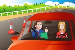 Adolescente em um teste de condução da estrada Foto de Stock