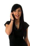 Adolescente emocionado en el teléfono celular Fotografía de archivo