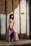Adolescente en alineada rosada Foto de archivo libre de regalías