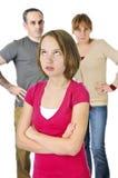 Adolescente en apuro con los padres Fotografía de archivo