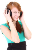 Adolescente en auriculares con los ojos cercanos Imagenes de archivo