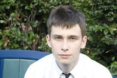 Adolescente en banco de parque Fotografía de archivo
