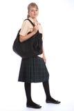 Adolescente en bolso del uniforme escolar y de hombro Imagen de archivo
