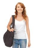 Adolescente en camiseta blanca en blanco con el bolso Fotografía de archivo