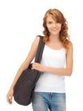 Adolescente en camiseta blanca en blanco con el bolso Imagen de archivo libre de regalías