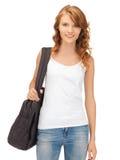 Adolescente en camiseta blanca en blanco con el bolso Foto de archivo libre de regalías