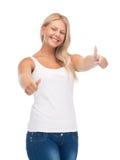 Adolescente en camiseta blanca en blanco con los pulgares para arriba Fotos de archivo