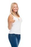 Adolescente en camiseta blanca en blanco con los pulgares para arriba Fotografía de archivo libre de regalías