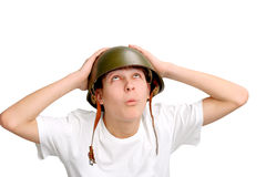 Adolescente en casco militar Fotografía de archivo
