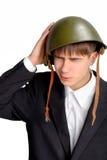 Adolescente en casco militar Fotos de archivo libres de regalías